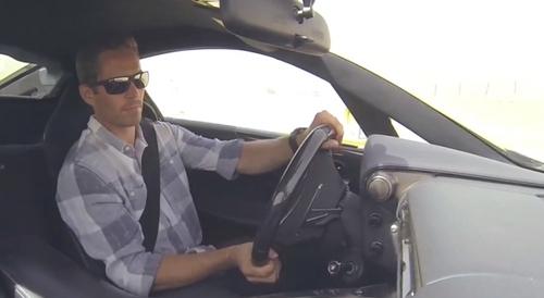 Paul behind the wheel of a car<3