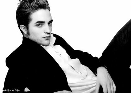 my sexylicious Robert with his hair slicked back<3