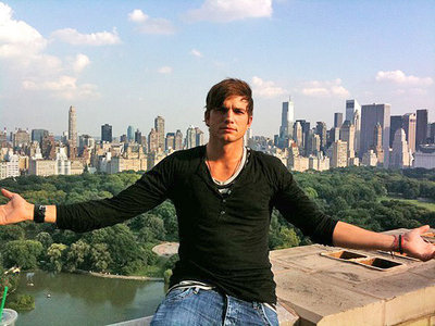 Ashton Kutcher with his arms stretched out