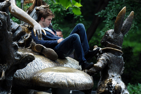 my beautiful Robert sitting on the 蘑菇 statue in New York's Central Park Alice in Wonderland statue<3