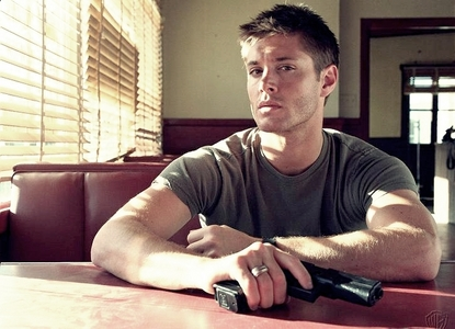 Jensen Ackles with a gun made of metal