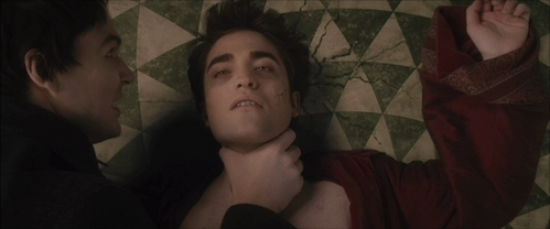 my sexy vampire Edward being choked da Felix in a scene from New Moon.Get your hands off Edward!!!