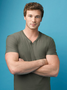 Derek Theler with his arms crossed <3