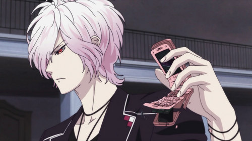 Subaru from Diabolik Lovers with a cellphone and using it to vent his anger.