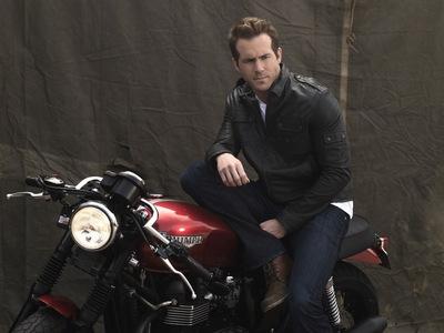 Ryan Reynolds on his motorcycle <3