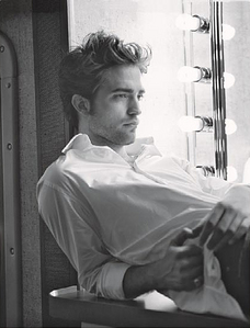 Robert with a lighted mirror beside him<3