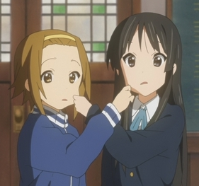 Mio (K-on!) and Ritsu pulling each others cheeks.