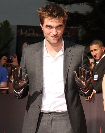 my handsome Robert with his cement covered hands up<3