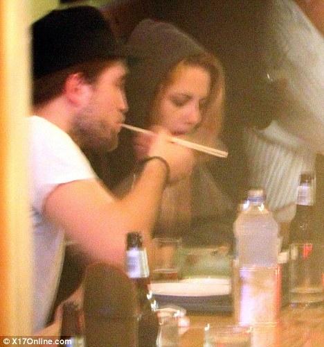 Robert and Kristen eating sushi<3