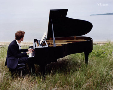 my handsome British babe playing the piano<3