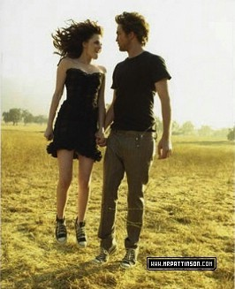 Robert and Kristen both wearing Converse sneakers from their 2008 VF photoshoot<3
