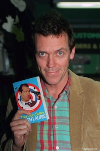 Hugh Laurie holding a book he has written <3