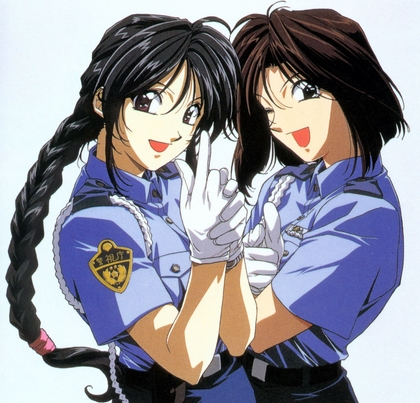 Hmm..Natsumi and Miyuki from You're Under Arrest! Come to mind!
