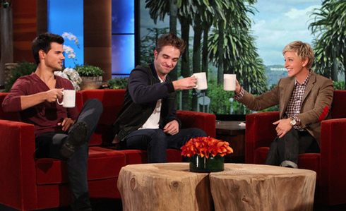 my handsome baby and his co-star,Taylor on the Ellen दिखाना holding coffee cups with water<3