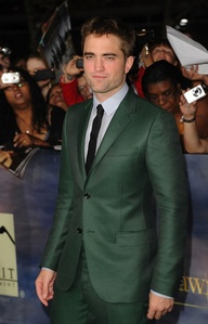 Robert looking sinfully sexy in a green suit at the BD 2 premiere<3