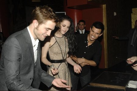 my handsome Robert(with Kristen and Taylor) showing his palm just before the actual handprint ceremony on Nov.3,2011<3