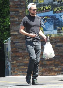 my handsome babe carrying a bag full of snacks<3