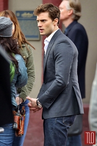 the sexy Christian Grey,aka Jamie Dornan in a grey suit jacket<3