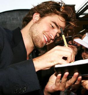 my gorgeous babe writing something for a fan<3