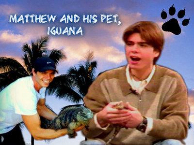 Matthew with his pet iguana. :)