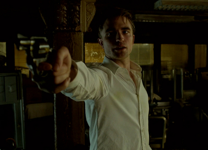 Robert holding a gun<3