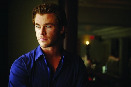 Chris wearing a deep blue shirt<3