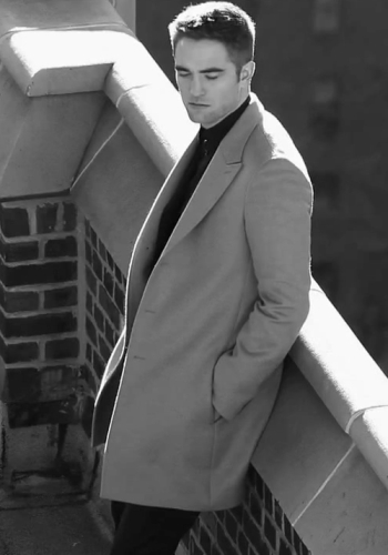 my handsome babe leaning against a wall<3