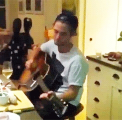 my gorgeous Robert playing the guitar<3