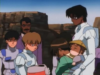 Uso Ewin held his mother's severed head in his arms after a failed attempt to save her. Victory Gundam, Episode 36