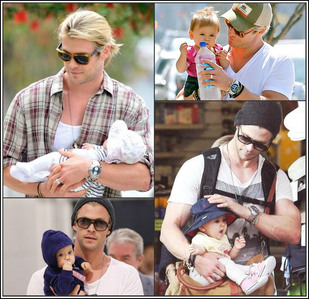 my Aussie hottie,Chris holding his baby daughter,India<3