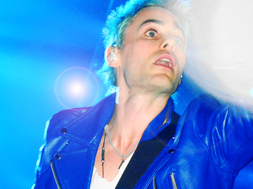 Jared Leto wearing a blue leather jacket<3