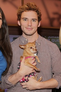 Sam holding a dog ! <33333
