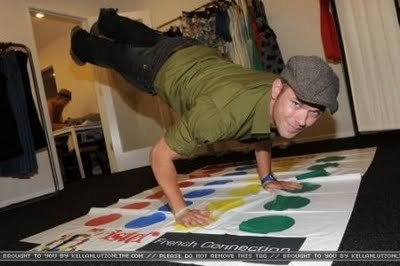 Kellan with his feet up in the air as he does pushups<3