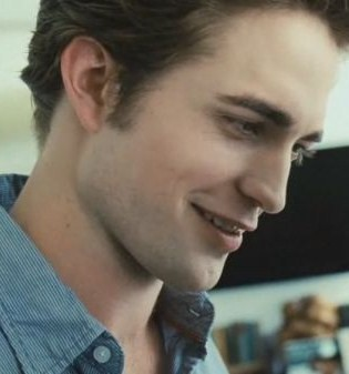 Edward's famous trademark crooked smile<3