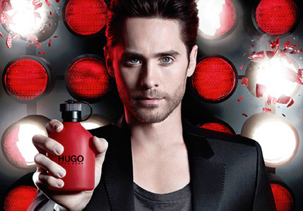 Jared with a red Hugo bottle<3