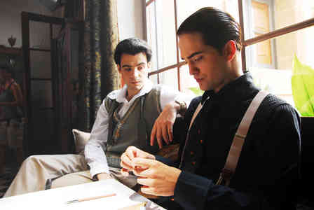 Robert in Little Ashes with gel in his hair<3
