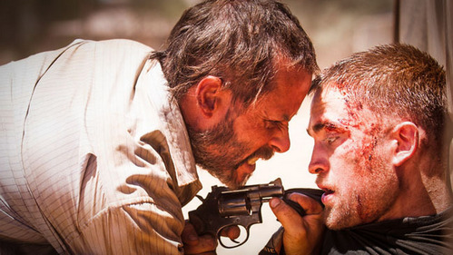 my babe looking scared with a gun in front of his face from The Rover<3