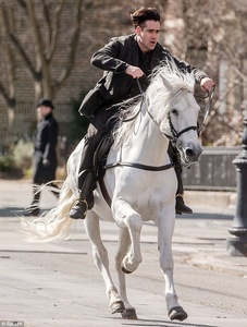 ... Because it's incredibly hot to see Colin Farrel on a big white horse