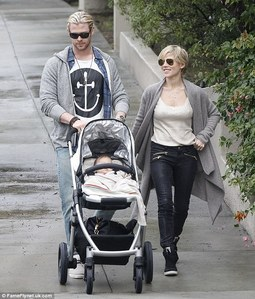 Chris with his wife and daughter<3