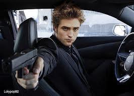 my sexy Rob holding a gun<3