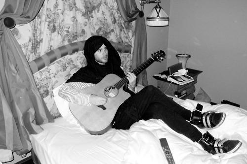 JL with a guitar<3