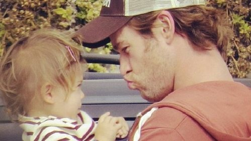 Chris making an adorable face at his daughter<3