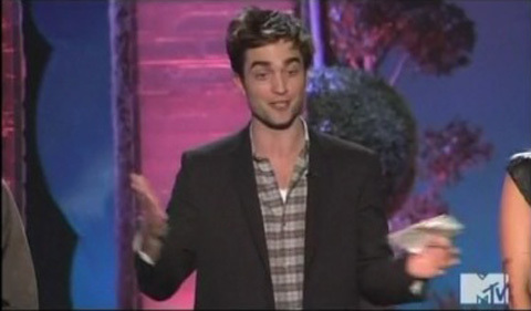 my handsome babe giving a speech about his WFE co-star,Reese Witherspoon at the 2011 mtv Movie Awards<3