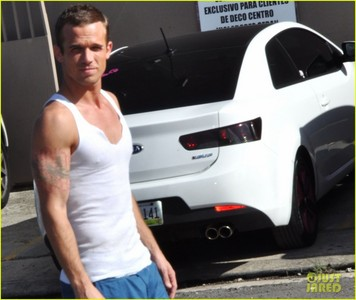 Cam in a white vest tank top<3