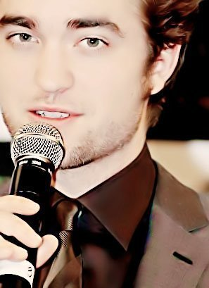 my gorgeous Robert with a microphone<3