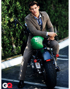 Taylor Lautner posing on a motorcycle<3
