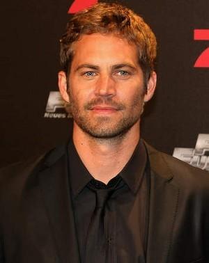 Paul in a black suit<3
