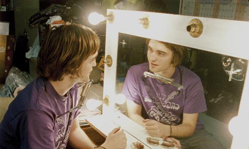 Robert looking in a mirror<3