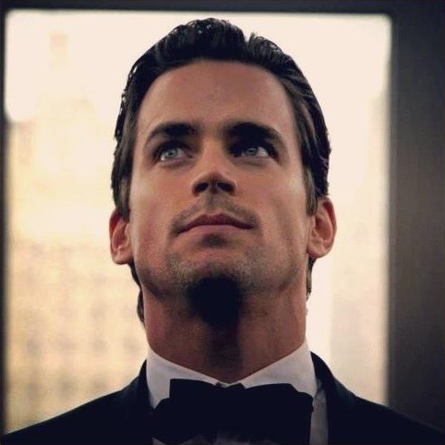 """Neal looking up at a TV screen (""""Dentist of Detroit"""") <33333"""