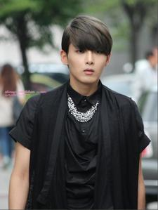 Ryeowook, because he is the person who has inspired me the most and taught me that te don't have to be an extrovert to perform and to be successful doing what te love. I think he's very unique looking as well:3 and I like it.
